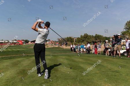 Ross Fisher of England tees off on the 9th hole, during the second round of the Abu Dhabi HSBC Golf Championship in Abu Dhabi, United Arab Emirates, 17 January 2019.