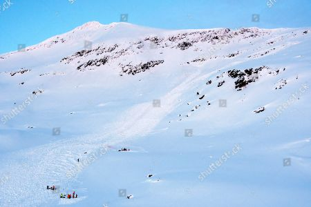 Crew from police and Red Cross have located and is digging up three of the four skiing tourists that were taken of an avalanche in mountain Blabafjellet, northern Norway, 17 January 2019. The tourists from Finland and Sweden were buried by a snow avalanche and presumed dead.