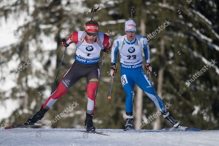 Simon Eder of Austria (L) and Tuomas Gronman of Finland (R) in action during the men's 10 km sprint race at the IBU Biathlon World Cup in Ruhpolding, Germany, 17 January 2019.