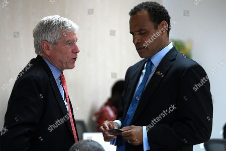 Nick Warner, Director-General of the Office of National Intelligence (L) speaks with Vanuatu Minister of Foreign Affairs Ralph Regenvanu (R), as he attends a bilateral meeting with Australian Prime Minister Scott Morrison and the Prime Minister of Vanuatu Charlot Salwai in Port Vila, Vanuatu, Australia, 16 January 2019. The prime minister will discuss Australian infrastructure investment, the Pacific labour hire scheme, and building cultural, economic and social ties between the two countries.