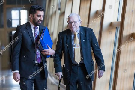 Humza Yousaf, Cabinet Secretary for Justice, and Jim Lynch, former editor of the Scots Independent newspaper, make their way to the Debating Chamber