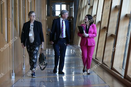 Claudia Beamish, Richard Leonard, Leader of the Scottish Labour Party, and Monica Lennon make their way to the Debating Chamber