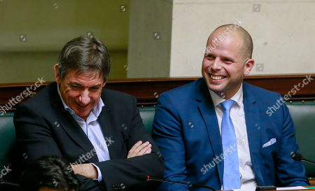 N-VA's Jan Jambon (L) smiles next to N-VA's former State secretary for asylum and immigration Theo Francke (R), during a plenary session of the chamber at the federal parliament in Brussels, Belgium, 17 January 2019. Mechelen councilman Melikan Kucam, a N-VA official, was arrested for human trafficking, criminal organization, passive bribery and extortion, the Antwerp prosecutor said. The Flemish nationalist party N-VA has suspended Mechelen city councillor Melikan Kucam from all his posts, after he was accused of asking payment in return for getting humanitarian visa issued to Christians from the Middle East.