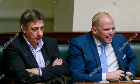 N-VA's Jan Jambon (L) sits next to N-VA's former State secretary for asylum and immigration Theo Francke (R), during a plenary session of the chamber at the federal parliament in Brussels, Belgium, 17 January 2019. Mechelen councilman Melikan Kucam, a N-VA official, was arrested for human trafficking, criminal organization, passive bribery and extortion, the Antwerp prosecutor said. The Flemish nationalist party N-VA has suspended Mechelen city councillor Melikan Kucam from all his posts, after he was accused of asking payment in return for getting humanitarian visa issued to Christians from the Middle East.