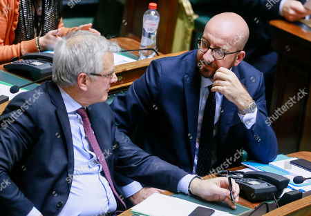 Vice-Prime Minister and Minister of Employment, Economy, Consumer Affairs and equal chances Kris Peeters (L) chat with  Belgian Prime Minister Charles Michel (R) during a plenary session of the chamber at the federal parliament in Brussels, Belgium, 17 January 2019. Mechelen councilman Melikan Kucam, a N-VA official, was arrested for human trafficking, criminal organization, passive bribery and extortion, the Antwerp prosecutor said. The Flemish nationalist party N-VA has suspended Mechelen city councillor Melikan Kucam from all his posts, after he was accused of asking payment in return for getting humanitarian visa issued to Christians from the Middle East.