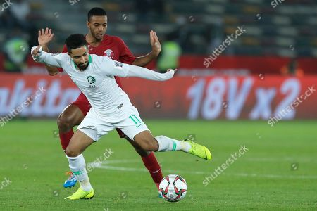 Saudi Arabia's midfielder Hattan Bahebri and Qatar's defender Salem Al Hajri fight for the ball during the AFC Asian Cup group E soccer match between Saudi Arabia and Qatar at Zayed Sport City Stadium in Abu Dhabi, United Arab Emirates