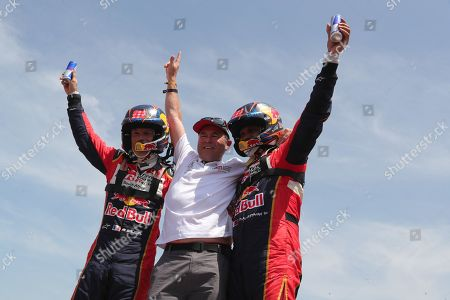 Qatar driver Nasser Al-Attiyah (R) and his co-driver French Matthieu Baumel (L) celebrate with the director of Toyota Gazoo Razing, Glyn Hall (C) after winning the Rally Dakar 2019, in Pisco, Peru, 17 January 2019. Al-Attiyah (Toyota) won his third Dakar, ahead of Spanish driver Joan 'Nani' Roma (Mini) and French driver Sebastien Loeb (Peugeot).