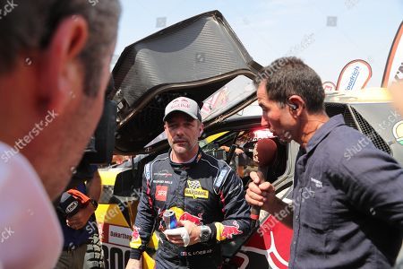 French driver Sebastien Loeb (Peugeot) speaks with the media after getting the third place in the Rally Dakar 2019, in Pisco, Peru, 17 January 2019