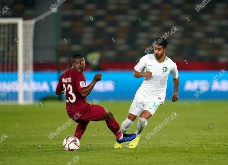 Housain Al-Mogahwi of Saudi Arabia dribbling the ball through the legs of Assim Madibo of Qatar during Saudi Arabia v Qatar at the Zayed Sports City Stadium in Abu Dhabi, United Arab Emirates, AFC Asian Cup, Asian Football championship