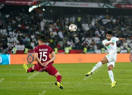 Housain Al-Mogahwi of Saudi Arabia shooting on goal in front of Bassam Al-Rawi of Qatar during Saudi Arabia v Qatar at the Zayed Sports City Stadium in Abu Dhabi, United Arab Emirates, AFC Asian Cup, Asian Football championship