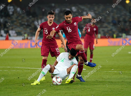Stock Photo of Housain Al-Mogahwi of Saudi Arabia and Boualem Khoukhi of Qatar challenging for the ball during Saudi Arabia v Qatar at the Zayed Sports City Stadium in Abu Dhabi, United Arab Emirates, AFC Asian Cup, Asian Football championship