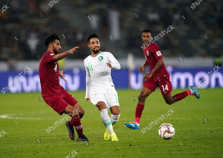 Hattan Bahebri of Saudi Arabia passing the ball in front of Tarek Salman of Qatar during Saudi Arabia v Qatar at the Zayed Sports City Stadium in Abu Dhabi, United Arab Emirates, AFC Asian Cup, Asian Football championship