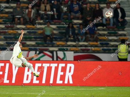 Housain Al-Mogahwi of Saudi Arabia shooting on goal during Saudi Arabia v Qatar at the Zayed Sports City Stadium in Abu Dhabi, United Arab Emirates, AFC Asian Cup, Asian Football championship