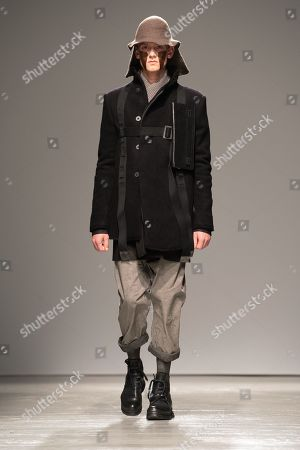 Stock Image of A model presents a creation from the Fall/Winter 2019/2020 Men's collection by German designer Boris Bidjan Saberi during the Paris Fashion Week, in Paris, France, 17 January 2019. The presentation of the Fall/Winter 2019/20 menswear collections runs from 15 to 20 January 2019.