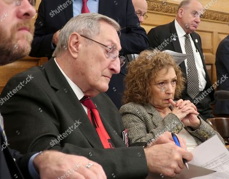 Larry Campbell. Kansas state Reps. Richard Proehl, left, R-Parsons, and Sydney Carlin, D-Manhattan, follow a briefing on Gov. Laura Kelly's budget proposals, at the Statehouse in Topeka, Kan. Kelly outlined an $18.4 billion spending blueprint for the budget year beginning in July