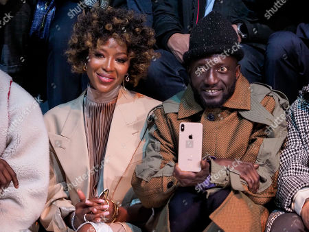 Stock Photo of Naomi Campbell and Jenke-Ahmed Tailly in the front row