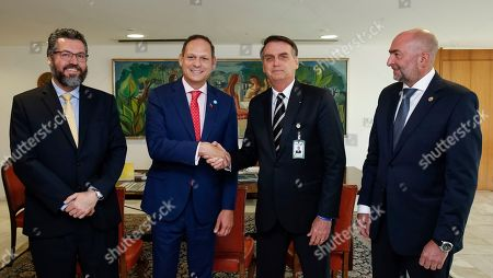 Jair Bolsonaro, Miguel Angel Martin, Gustavo Cinosi, Ernesto Araujo, Ivan Monteiro, Michel Temer, Moreira Franco, Eduardo Guardia. In this photo released by Brazil's presidential press office, Brazil's President Jair Bolsonaro, second right, shakes hands with the President of the Supreme Court of Justice of Venezuela in exile, Miguel Angel Martin, accompanied by Foreign Minister Ernesto Araujo, left, and the representative of the Organization of American States Gustavo Cinosi, during a meeting at the Planalto presidential palace, in Brasilia, Brazil