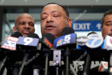 Rev. Marvin Hunter, Laquan McDonald's great-uncle, reacts as he speaks at to reporters after a judge acquitted three Chicago police officers of trying to cover up the 2014 shooting of black teenager Laquan McDonald, in Chicago. Judge Domenica Stephenson said that after considering all of the evidence, including police dashcam video of the killing, she didn't find that officer Thomas Gaffney, Joseph Walsh and David March conspired to cover up the shooting. The officer who shot McDonald 16 times, Jason Van Dyke, was convicted of murder in October and is due to be sentenced Friday