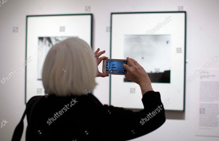 Stock Picture of A woman takes pictures of photographs by Mexican photographer Graciela Iturbide on display at the Museum of Fine Arts in Boston, Massachusetts, USA, 17 January 2019. Nearly 140 photographs by Iturbide portraying her native country of Mexico will be on exhibit starting 19 January through 12 May 2019.