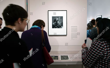 People look at a photograph titled 'Our Lady of the Iguanas, Juchitan, Mexico 1979' by Mexican photographer Graciela Iturbide on display at the Museum of Fine Arts in Boston, Massachusetts, USA, 17 January 2019. Nearly 140 photographs by Iturbide portraying her native country of Mexico will be on exhibit starting 19 January through 12 May 2019.