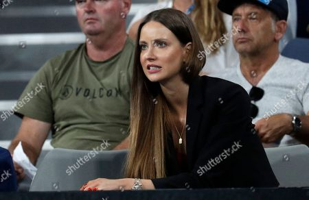 Ester Satorova, wife of Tomas Berdych of the Czech Republic watches his third round match against Argentina's Diego Schwartzman at the Australian Open tennis championships in Melbourne, Australia