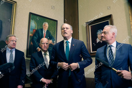 Washington Gov. Jay Inslee, second from right, speaks to the media as former California Gov. Jerry Brown, second from left, looks, in Olympia, Wash., . Inslee, Brown and several Washington lawmakers met to discuss Inslee's climate agenda