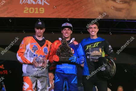 (L-R) Argentinian drivers Gustavo Gallego, Nicolas Cavigliasso and Jeremias Gonzzlez Ferioli pose on the podium after finishing in fifth, first and third place, respectively, in the quads category of the Dakar Rally 2019, in Pisco, Peru, 17 January 2019.