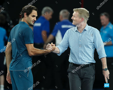 TV Moderator Jim Courier and Roger Federer