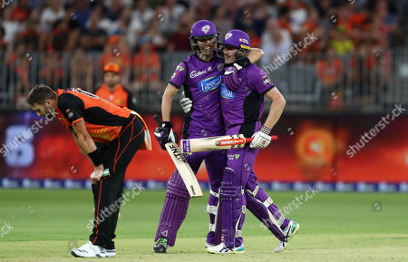 James Faulkner of the Hurricanes celebrates with Johan Botha of the Hurricanes after hitting the winning runs, with bowler Andrew Tye of the Scorchers looking dejected