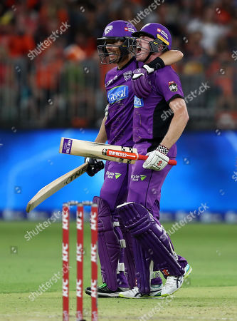 James Faulkner of the Hurricanes celebrates with Johan Botha of the Hurricanes after hitting the winning runs