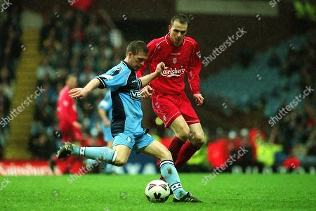 Dannie Bulman of Wycombe Wanderers gets ready to pass the ball upfield as Liverpool's Dietmar Hamann looks on. Dannie is still playing twenty years on for Crawley Town and celebrates his 40th Birthday on January 24th 2019 during Wycombe Wanderers vs Liverpool, FA Cup Semi-Final Football at Villa Park on 8th April 2001