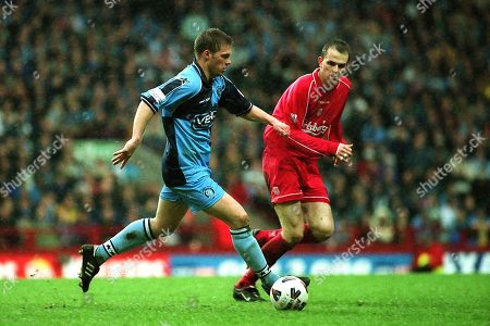 Dannie Bulman of Wycombe Wanderers dribbles the ball upfield as Liverpool's Dietmar Hamann looks on. Dannie is still playing twenty years on for Crawley Town and celebrates his 40th Birthday on January 24th 2019 during Wycombe Wanderers vs Liverpool, FA Cup Semi-Final Football at Villa Park on 8th April 2001