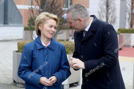 German Defense Minister Ursula von der Leyen talks with Austrian Defense Minister Mario Kunasek, from left, before a military ceremony ahead of their meeting in Vienna, Austria