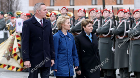 Austrian Defense Minister Mario Kunasek, German Defense Minister Ursula von der Leyen and Swiss Defense Minister Viola Amherd, from left, attend a military ceremony ahead of their meeting in Vienna, Austria