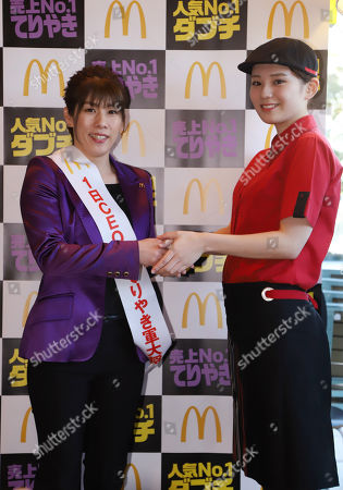 Three times Olympic wrestling gold medalist Saori Yoshida smiles as she acts as CEO-for-a-day of McDonald's restaurant chain at a McDonald's restaurant in Tokyo. Yoshida attended her first comercial event after she announced reirement from wrestling career last week.