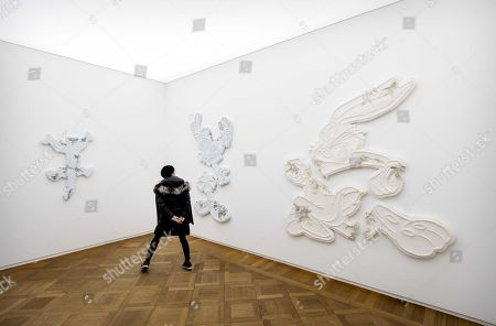 A visitor looks on an installation by the New York artist Daniel Arsham on display at his solo exhibition 'Connecting Tim' in the Moco Museum in Amstredam, the Netherlands, 18 January 2019. Arsham incorporates various disciplines architecture, design, sculpture, film and fine art into his works.
