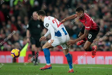 Stock Photo of Manchester United forward Marcus Rashford right reels away from a challenge on Martin Montoya of Brighton & Hove Albion