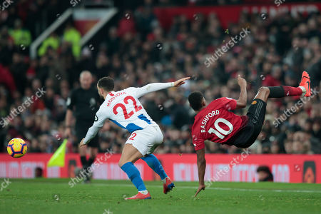 Stock Image of Manchester United forward Marcus Rashford right reels away from a challenge on Martin Montoya of Brighton & Hove Albion