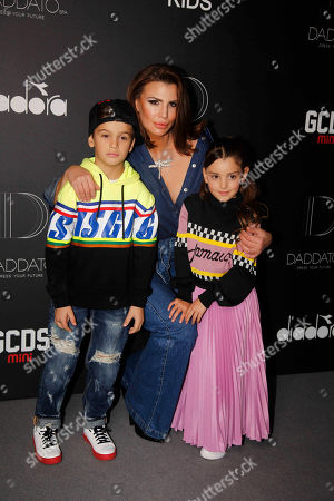 Stock Photo of Claudia Galanti and her sons Tal and Liam Mimran
