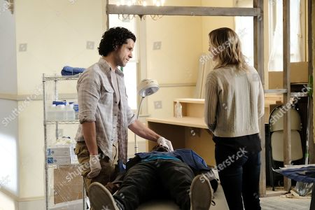 """THE RESIDENT:  L-R:  Guest star Miles Gaston Villanueva and Emily VanCamp in the """"After the Fall"""" winter premiere episode of THE RESIDENT airing Monday, Jan. 14 (8:00-9:00 PM ET/PT) on FOX. ©2018 Fox Broadcasting Co. Cr: Guy D'Alema/FOX."""