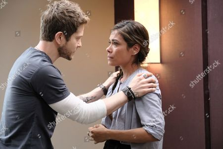 Matt Czuchry as Conrad Hawkins and Daniella Alonso as Zoey Barnett