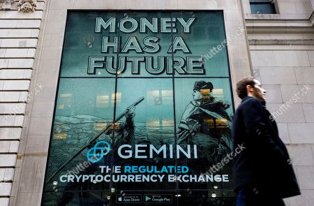 A person walks past an advertisement for Gemini, a cryptocurrency exchange founded by Cameron and Tyler Winklevoss in 2014, in New York, New York, USA, 18 January 2019. The cryptocurrency industry, which includes Bitcoin and other similar digital forms of currency, is growing but is still struggling to achieve mass market usage.