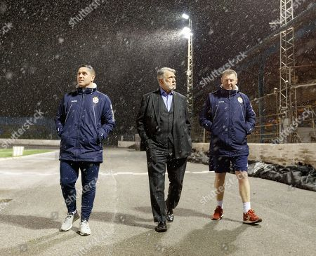 Stock Picture of Cowdenbeath Assistant Manager Mark Fotheringham, Cowdenbeath Chairman Donald Findlay QC & 1st Team Coach Ian Flaherty walk round the pitch at Central Park shortly after Cowdenbeath's William Hill Scottish Cup 4th Round tie against Rangers. The match was postponed due to a frozen pitch.