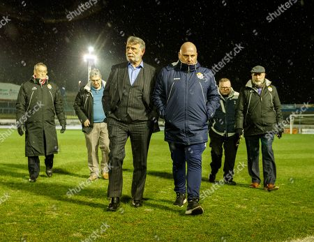 Stock Photo of Cowdenbeath Chairman Donald Findlay & Cowdenbeath Manager Gary Bollan walk on the pitch shortly after Cowdenbeath's William Hill Scottish Cup 4th Round tie against Rangers. The match was postponed due to a frozen pitch.