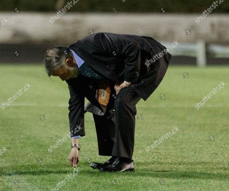 Cowdenbeath club Chairman Donald Findlay QC tries to dig his car keys into the pitch at Central Park shortly after Cowdenbeath's William Hill Scottish Cup 4th Round tie against Rangers. The match was postponed due to a frozen pitch.