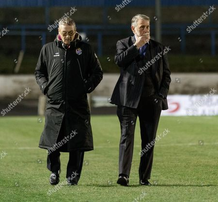 Cowdenbeath club Chairman Donald Findlay QC (right) walks on the pitch at Central Park shortly after Cowdenbeath's William Hill Scottish Cup 4th Round tie against Rangers. The match was postponed due to a frozen pitch.