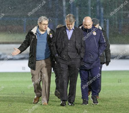 Cowdenbeath club Chairman Donald Findlay QC (centre) & Cowdenbeath Manager Gary Bollan walk on the pitch at Central Park shortly after Cowdenbeath's William Hill Scottish Cup 4th Round tie against Rangers. The match was postponed due to a frozen pitch.