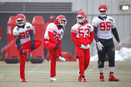 Kansas City Chiefs cornerback Steven Nelson (20), defensive back Orlando Scandrick (22), inside linebacker Anthony Hitchens (53) and defensive end Chris Jones (95) stretch during workouts, in Kansas City, Mo. The Chiefs host the New England Patriots in the NFL 's AFC football championship game Sunday