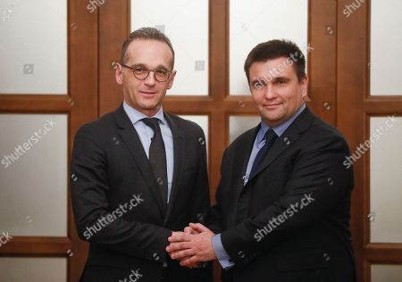 Ukrainian Foreign Minister Pavlo Klimkin (R) shakes hands with his German counterpart Heiko Maas (L) during their meeting in Kiev, Ukraine, 18 January 2019. Heiko Maas arrived in Kiev for a one-day working visit to meet with top Ukrainian officials.