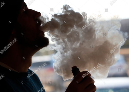 74caff56e Richmonder Coleman Wheeler emits a cloud of smoke from a vape pipe at a  local vape